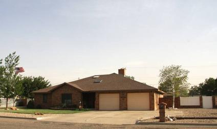 $295,000 Portales 4BR 3BA, The home features 2 Living Areas